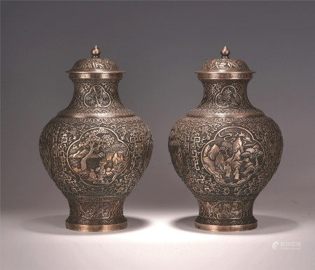 A PAIR OF CHINESE PURE SILVER LIDDED VASE