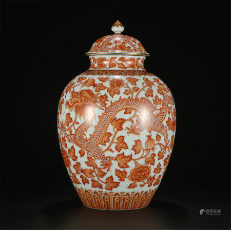 A CHINESE CORAL RED DRAGON AND PEONY LIDDED JAR