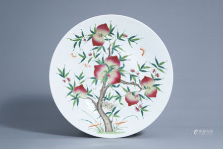 A large Chinese famille rose 'nine peaches' charger,