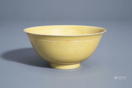 A Chinese yellow ground bowl with incised underglaze