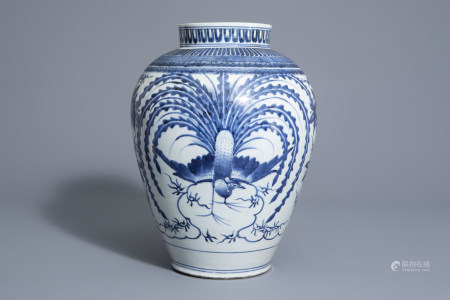 A Japanese blue and white Arita 'peacocks' vase, Edo,