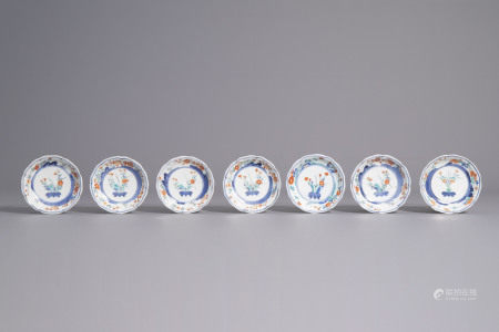 Seven Japanese Kakiemon saucers with flower baskets and