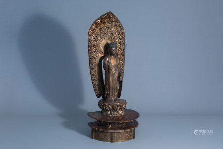 A Japanese gilt and lacquered wood figure of Buddha
