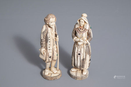 A pair of Japanese ivory and bone okimono of an