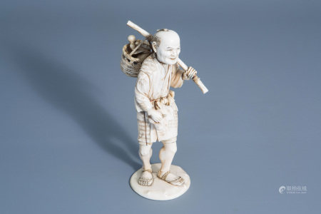 A Japanese ivory okimono of an elderly farmer, signed,