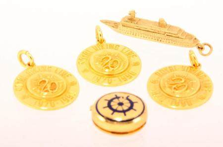 Various gold pendants, pins, etc. with a maritime theme, inc