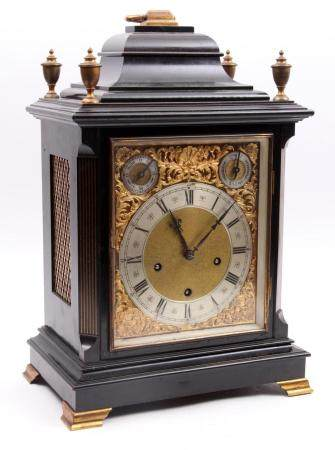 Antique English table clock in an ebonised case, h.52 x w.34