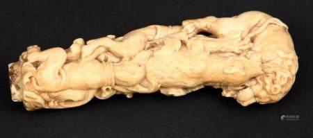 Antique ivory walking stick / knife knob depicting various f
