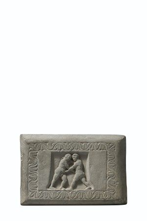 A RARE CARVED GRAY SCHIST WRESTLER'S WEIGHT