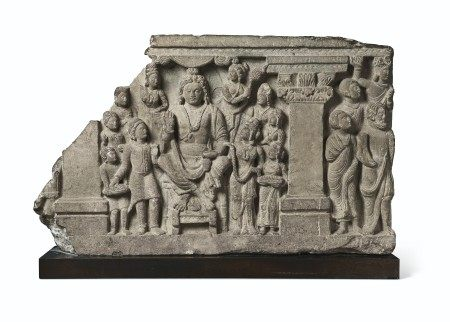 A GRAY SCHIST RELIEF WITH THE BODHISATTVA MAITREYA AND DEVOTEES