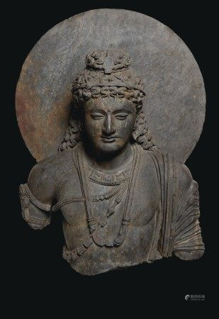 A MONUMENTAL GRAY SCHIST BUST OF A BODHISATTVA