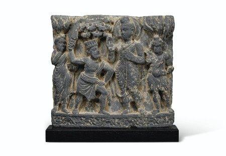 A GRAY SCHIST RELIEF DEPICTING BUDDHA SHAKYAMUNI CONFRONTED BY AN ASSASSIN OF DEVADATTA