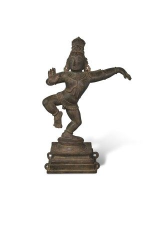 A RARE BRONZE FIGURE OF DANCING KRISHNA
