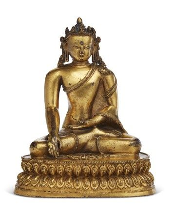 A GILT-COPPER FIGURE OF A CROWNED BUDDHA
