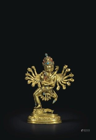 AN IMPORTANT GILT-BRONZE FIGURE OF KAPALADHARA HEVAJRA