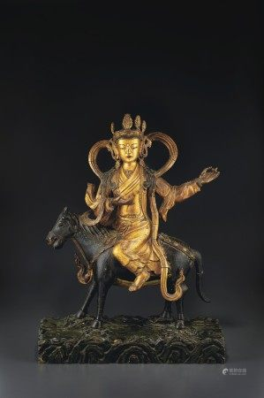 A GILT-LAQUERED WOOD FIGURE OF SERCHEN KHADING DORJE LUMO GYAL