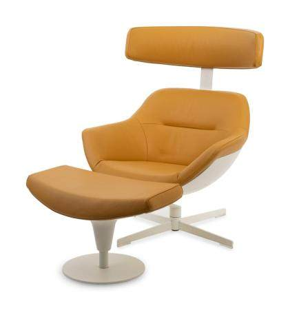 A Post Modern Leather Upholstered Lounge Chair and Ottoman C