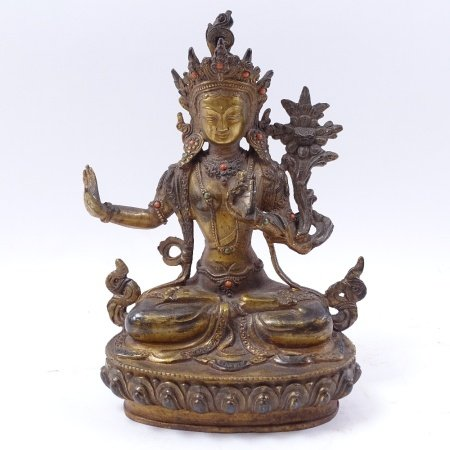 A Chinese patinated bronze deity, seated on lotus base with engraved signature, height 22cm