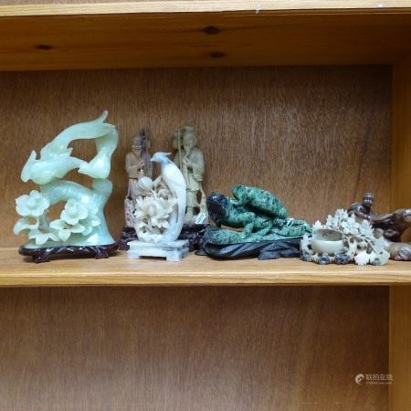 A collection of various Oriental soapstone and jadeite carvings, including water buffalo and birds-