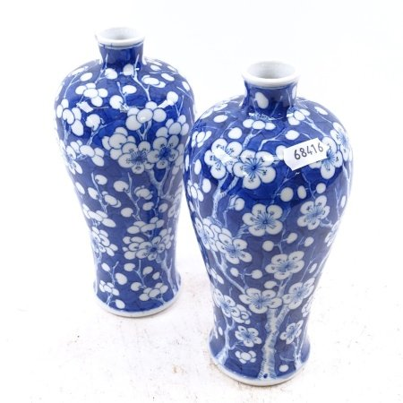 A pair of Chinese porcelain blue and white Prunus pattern Meiping vases, 6 character mark on base,