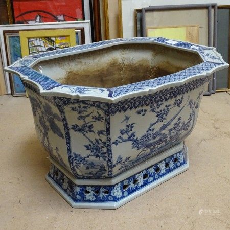 A large Chinese blue and white painted jardiniere, with bird and floral decoration, and shaped