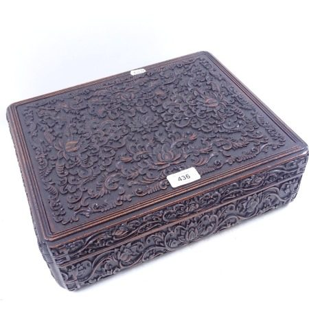 A Chinese carved wood box with allover foliate and floral scrolled decoration, length 36cm