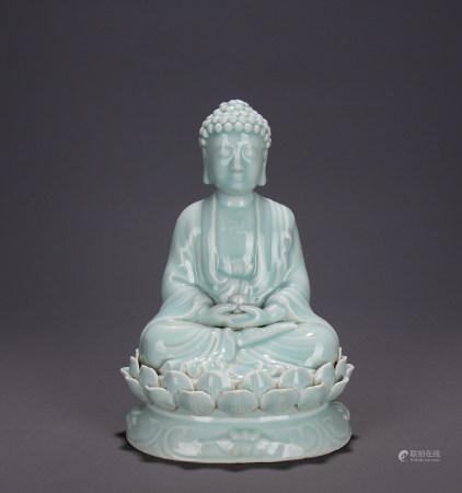 A Chinese Celadon-Glazed Porcelain Medicine Buddha Statue