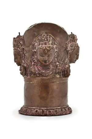 A COPPER REPOUSSÉ CHATURMUKHALINGA COVER NEPAL, 15TH-16TH CENTURY