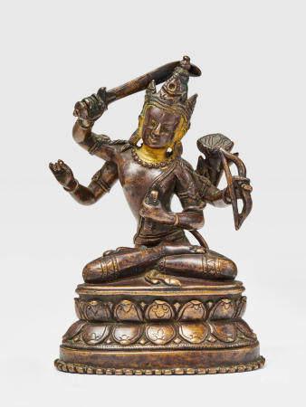 A BRASS FIGURE OF MANJUSHRI NAMASANGITI KURKIHAR, NORTHEASTERN INDIA, 12TH CENTURY
