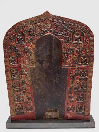 A POLYCHROMED WOOD TORANA WITH TWELVE BODHISATTVAS TIBET, CIRCA 13TH CENTURY