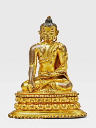 A GILT COPPER ALLOY FIGURE OF BUDDHA NEPAL, 14TH CENTURY