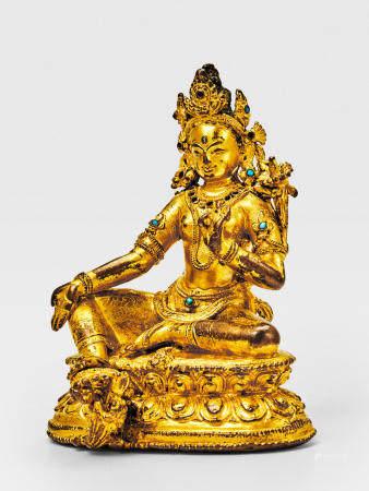 A GILT COPPER ALLOY FIGURE OF GREEN TARA NEPAL, 14TH CENTURY