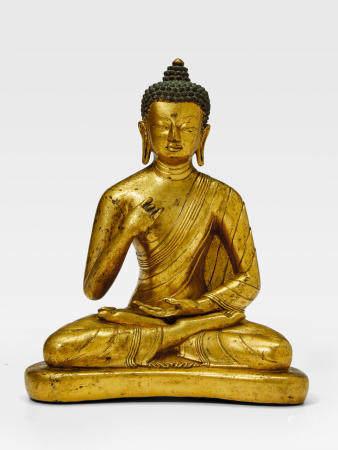 A GILT COPPER ALLOY FIGURE OF THE CONFESSION BUDDHA SUVIKRANTA TIBET, CIRCA 17TH CENTURY