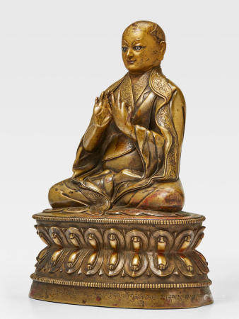 A SILVER AND COPPER INLAID BRASS FIGURE OF DRAKPA GYALTSEN TSANG, CENTRAL TIBET, 15TH CENTURY