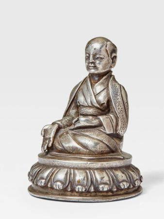 A SILVER FIGURE OF SACHEN KUNGA NYINGPO TIBET, CIRCA 16TH CENTURY