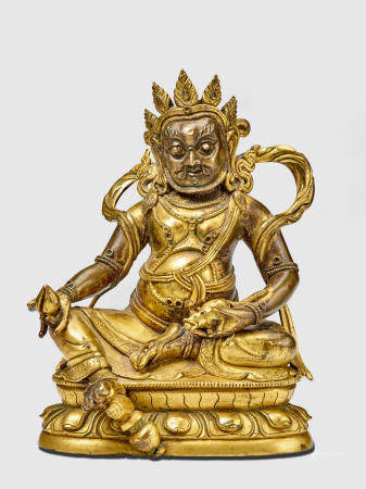 A GILT COPPER ALLOY FIGURE OF YELLOW JAMBHALA QING DYNASTY, 18TH/19TH CENTURY