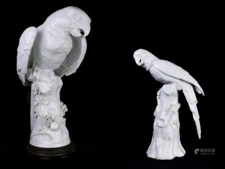 A lot of two Continental blanc de chine porcelain figures of a parrot