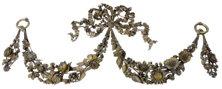 A carved and gilt floral decorated swag form mount