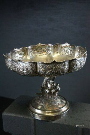 A Chinese export silver tazza, mark of Wang HIng of Honk Kong, of shaped petal outline, supported by