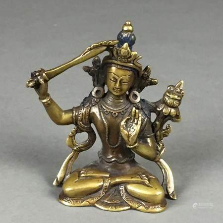 Bodhisattva Manjushri - Tibet nach 1900, Gelbguss, in Padmasana sitzend, mit dem Schwert der