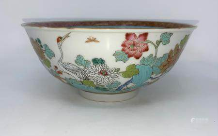 A Chinese 19th century bowl with polychrome decoration, birds etc, four character mark to base,