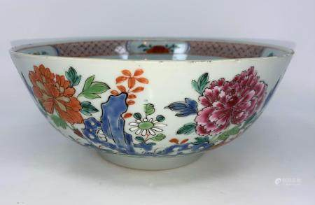 An 18th century Chinese punch bowl with polychrome decoration of flowers, diameter 24cm (minor