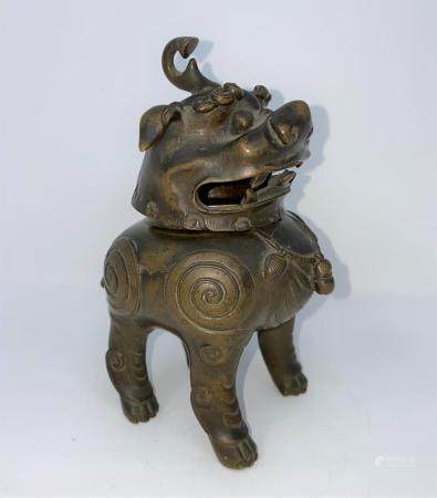 An 18th century Chinese bronze incense burner in the form of a mythical beast, height 15cm