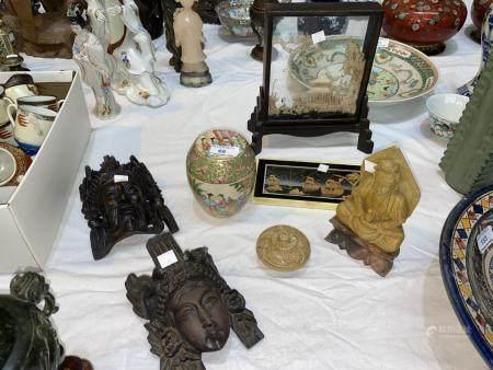 A carved soapstone Buddha figure; 2 oriental carved wood heads; a polished stone small trinket