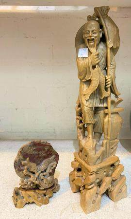 A Chinese brown soapstone figure of a fisherman holding a rod and fish, height 35 cm; a similar