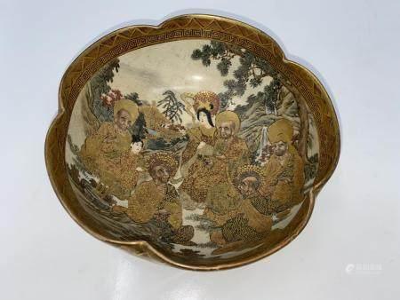 A Satsuma circular lobed bowl decorated with immortals, character seal to base Satsuma and Hododa
