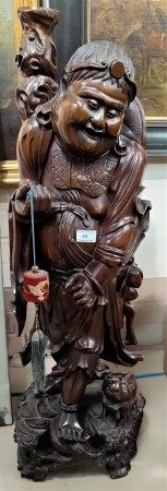 A large Chinese carved wooden figure of a sage walking with a small animal. height 90cm