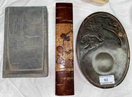 A Chinese scholar's ink stone of oval form, with carved dragon decoration, another intaglio