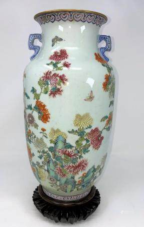 A Chinese vase decorated with detailed flowers and insects, flared rim and 2 handles with