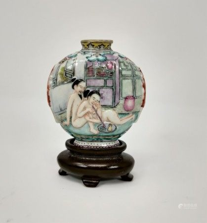 A Chinese porcelain snuff bottle on stand, nude figures smoking to one side, characters to the